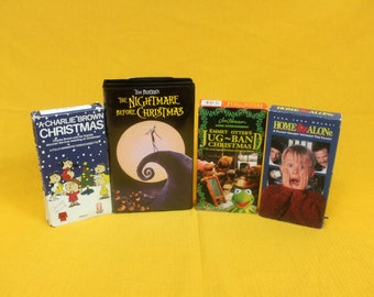 Set Of 4 Christmas Movie VHS. Home Alone, Emmet Otters Jug Band Christmas, Charlie Brown Christmas, Nightmare Before Christmas VHS Set