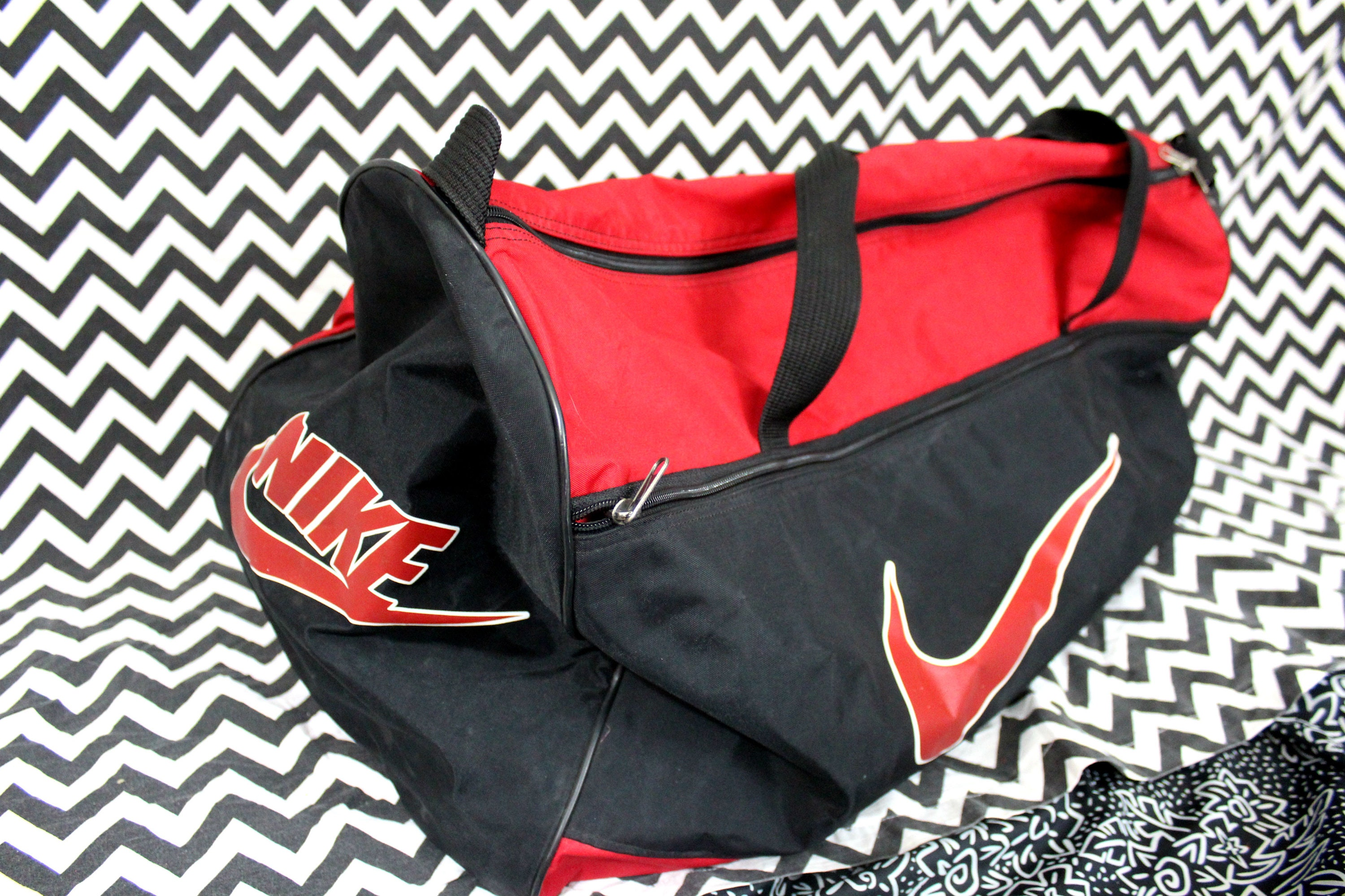 0aa8e47d35cf Vintage Nike Duffel Bag. 90s Hip Hop Overnight Duffel Bag. Retro 80s or 90s  Carry On Bag. Old School Nike Red And Black Logo Duffel Bag.