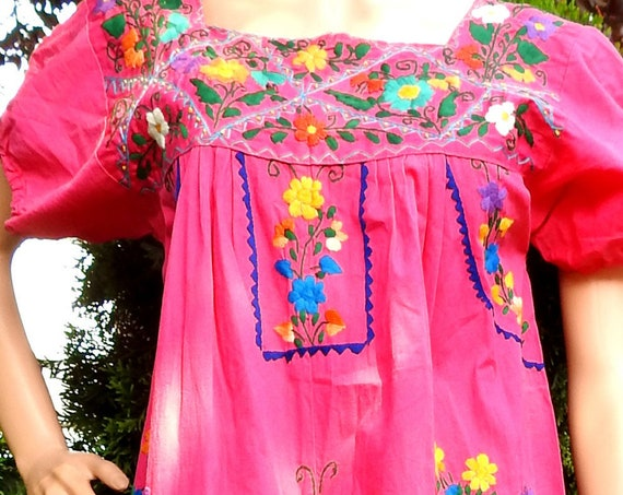 Pink dress with hand embroidery, floor length, from Mexico.