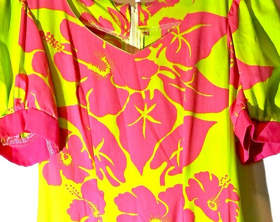 Yellow dress with pink ruffle