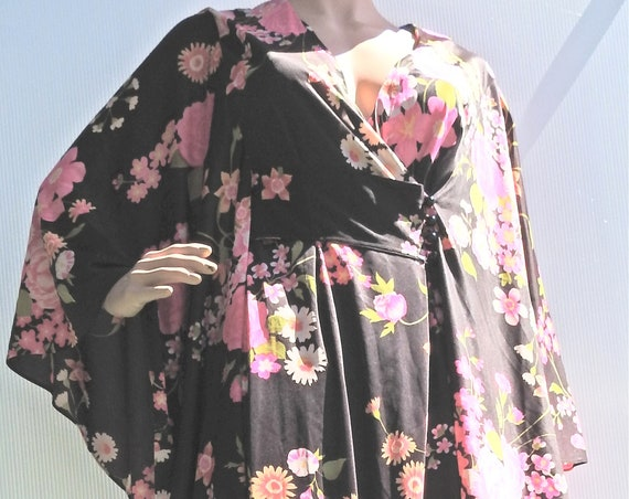 CAFTAN DRESS with butterfly SLEEVES and mixed floral print.