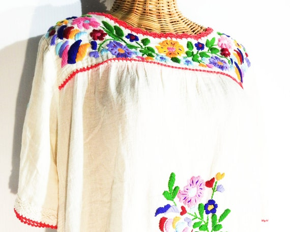 Hand embroidered cotton tunic dress with floral embroidery