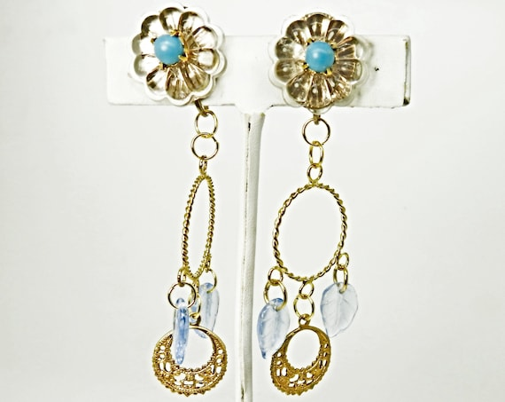 clip on earrings with blue leaves