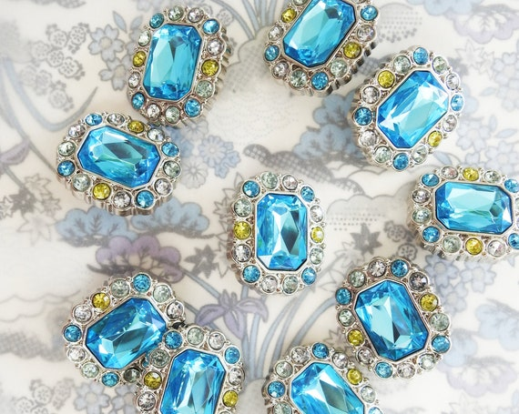 Large blue rhinestone buttons