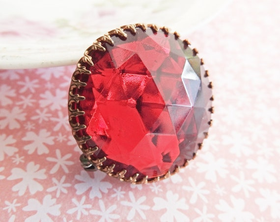 Red round brooch