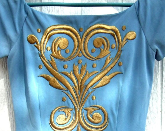 Vintage dress for woman with embroidery.