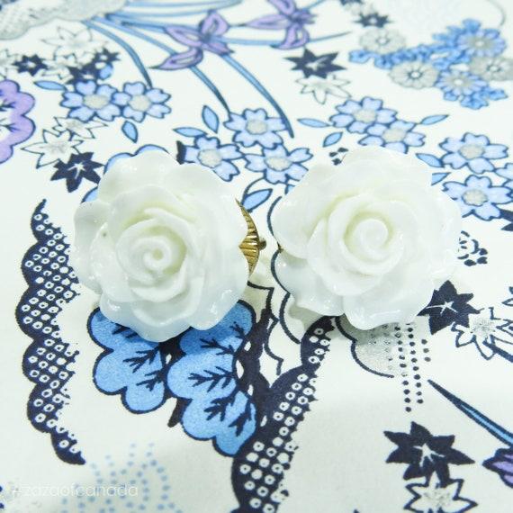 White flower clip on earrings