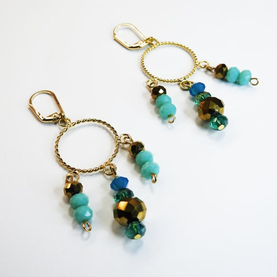 Dangly hoop earrings with beads blue