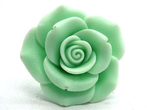 Green resin ring, floral and chunky.