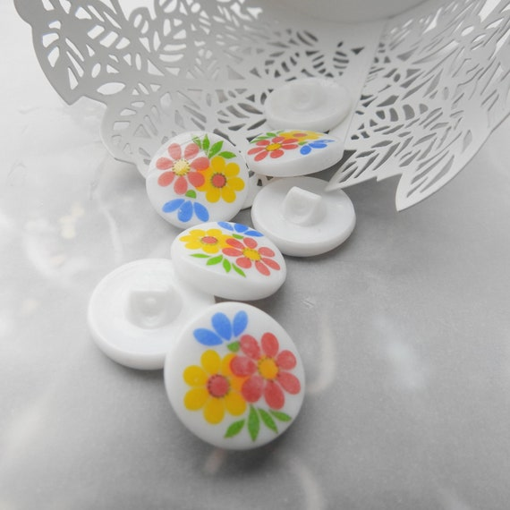 Glass buttons with flowers