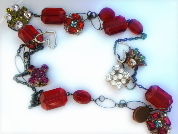 Unique Red upcycled jewelry statement necklace with strawberry and heart.