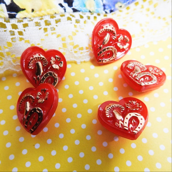 Small red heart buttons