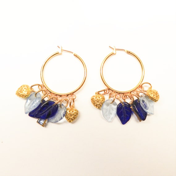 Blue hoop earrings with charms