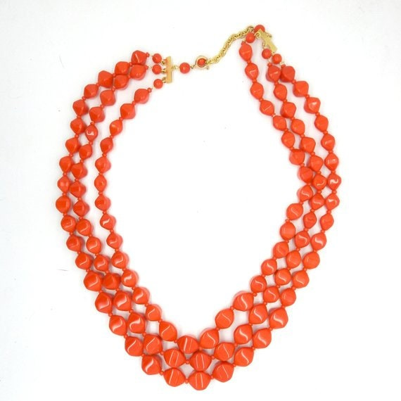 Statement jewelry red multi strand necklace.