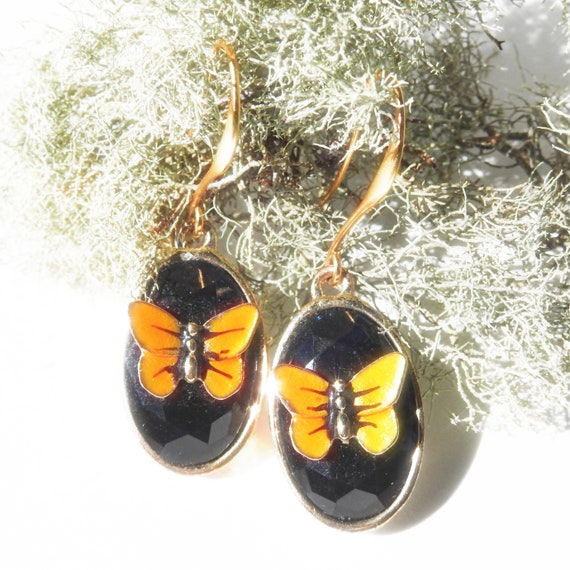 Butterfly earrings dangle for women.