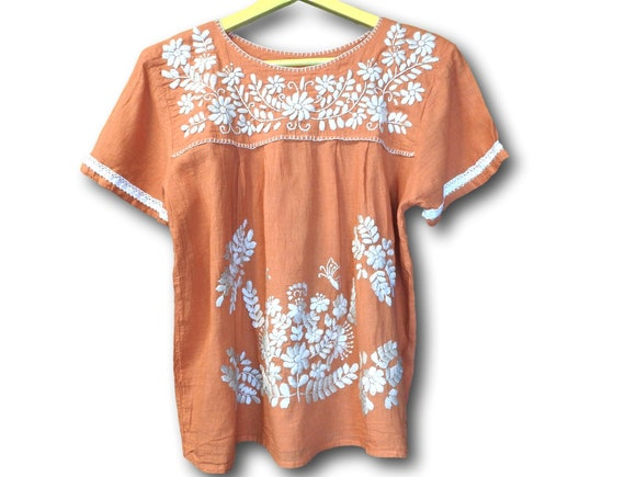 Burnt orange floral embroidered blouse with Mexican embroidery.