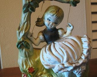 Planter girl on plastic swing. Vase inner garden. Made in the United States