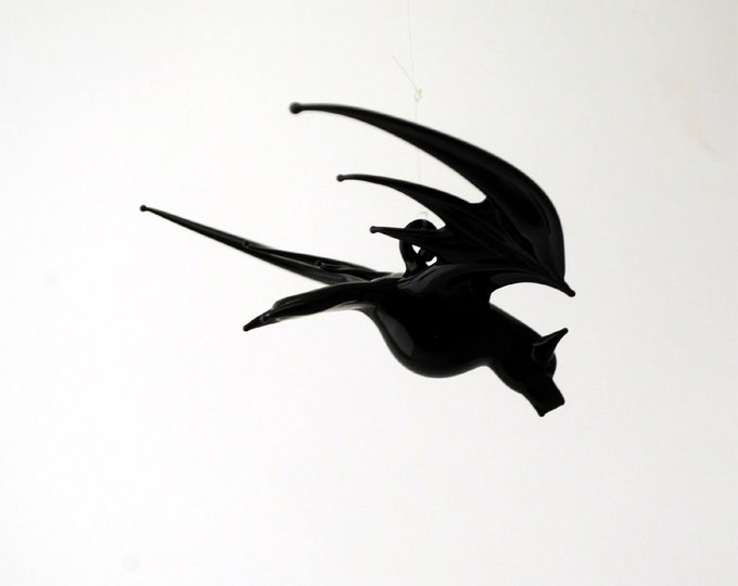 e38-003B Small Bat in Flight