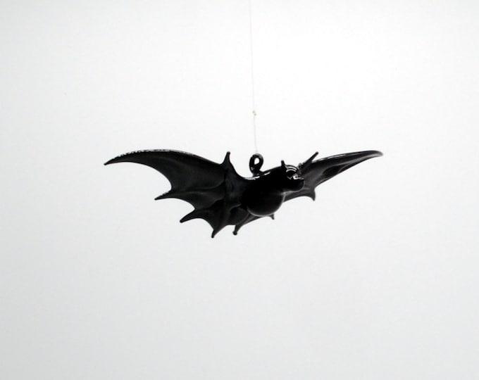 e38-003C Small Bat in Flight