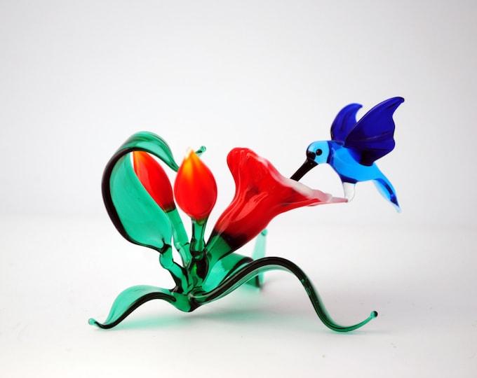 Hummingbird on Flower Stand