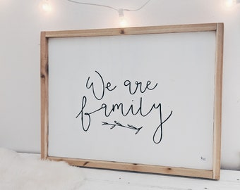 we are family black and white wooden sign