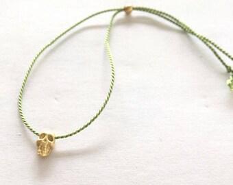 Silk string bracelet, dainty skull charm, multiple silk string colours available