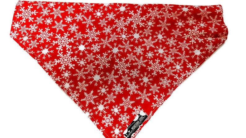 red with snowflakes dog bandana over the collar christmas image 0