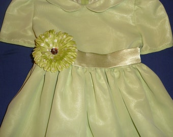 Green dress with sash and flower