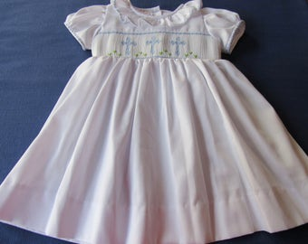 Hand smocked withe dress with light blue crosses