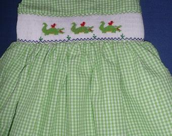Hand smocked dress with alligators