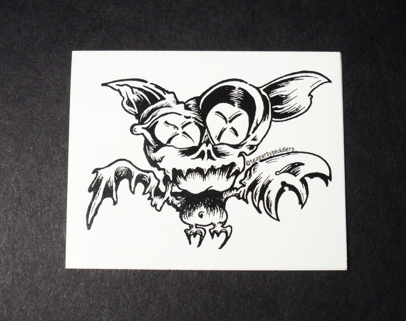 Black and White Vinyl Stickers Original Design of Cartoon Bat with Abstract Wings and Wild Eyes!