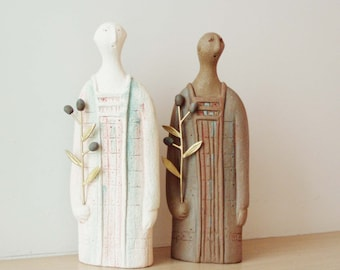 Figure with olive branch sculpture, ceramic sculpture of a robed figure, holding a brass olive branch, made to order