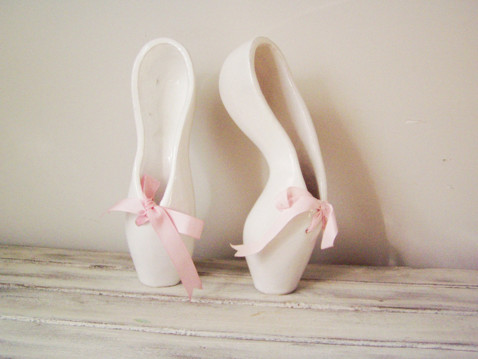 ballerina shoes sculpture, ceramic ballerina shoes of high fire, stoneware clay in milky white with satin, pink ribbons, ballet