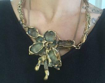 Brass rosebuds.