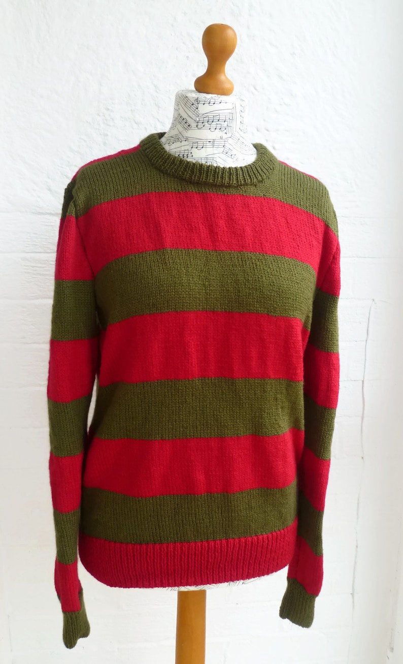67c604fdcac Freddy Krueger Movie Versions Part I to VII Sweater Sweater