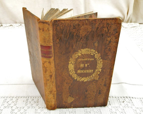 Antique French 1837 History Book with Leather Bound Cover Adorned with Gold Gilt Antiquités Nationales by M. Boutteville from France