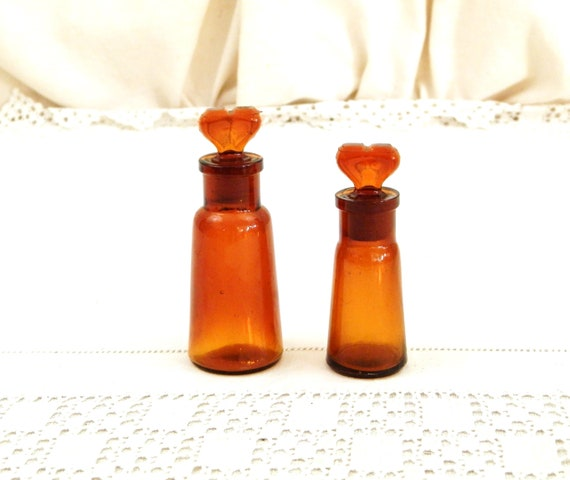 2 Small Antique Amber Colored Glass Medicine / Perfume Bottles with Heart Shaped Stoppers, Retro Curio Apothecary Collectibles from France