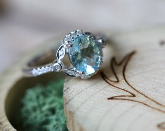 14K White Gold Engagement Ring with an Oval Aquamarine and Diamond Halo - Staghead Designs