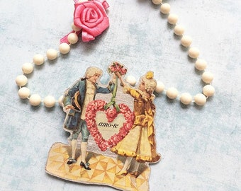Statement Necklace - art jewelry - paper vintage figures - floral jewelry - long pearls necklace - roses necklace - locket - fabric rose