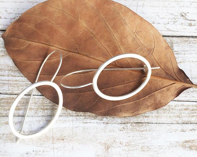 Big open oval silver hook earrings - geometric statement earrings