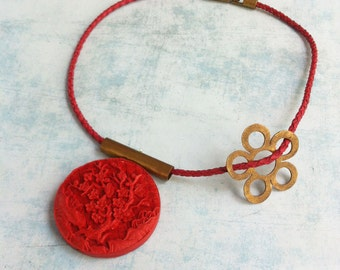 Bib Necklace - Red medallion with a cherry tree, double side -brass flower -asymmetric - leather - locket necklace