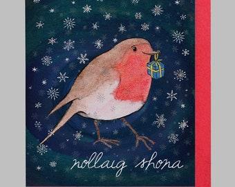 Robin holding present, cártaí nollag, Nollaig Shona, christmas card in Irish