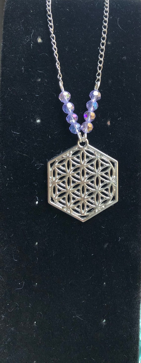 Silver colored Flower of Life Yoga Meditation symbol Necklace with color changing Crystals Violet to Blue