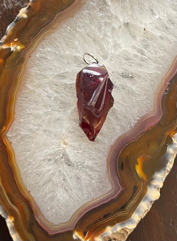 Small Andarian Flame Red Crystal with a tiny Skull Pendant