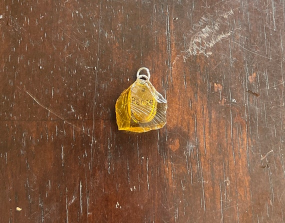 Small Andarian Champagne Crystal with the word Peace     Pendant