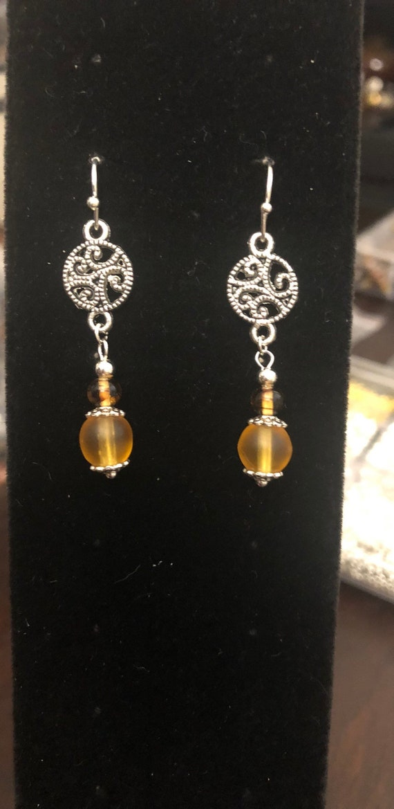 7.00 Silver colored Spiral Earrings with Topaz colored frosted Glass beads
