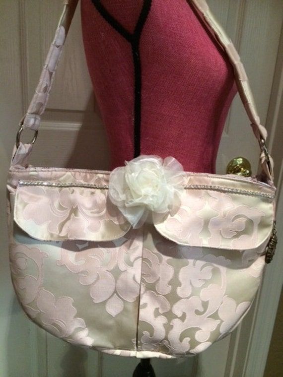 Luxurious Satin and Crystal Diaper Bag! matches the Rosa Baby Bedding.