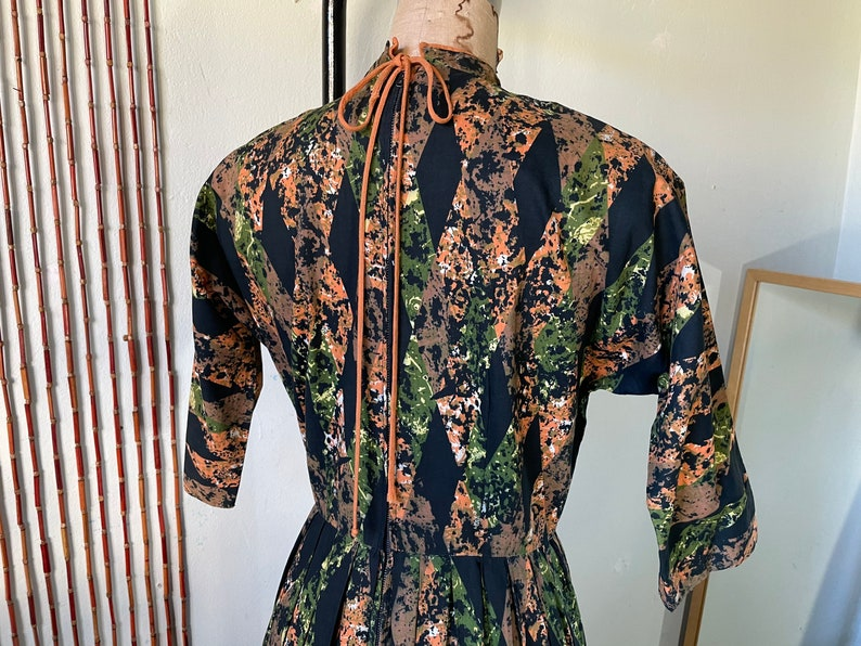 1950s Cotton Batik Day Dress by Barbette  34 Sleeve Pleated Full Skirt  Orange Green and Black  Mid Century Stepford New Look