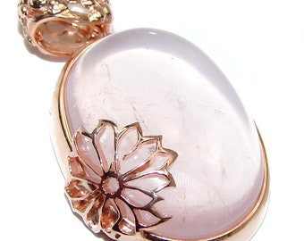 3 8 W Rose Quartz Sterling Silver Ring weight 7.00g code 18-maj-20-18 T- 3 8 inch dim L- 5 8 Size 8