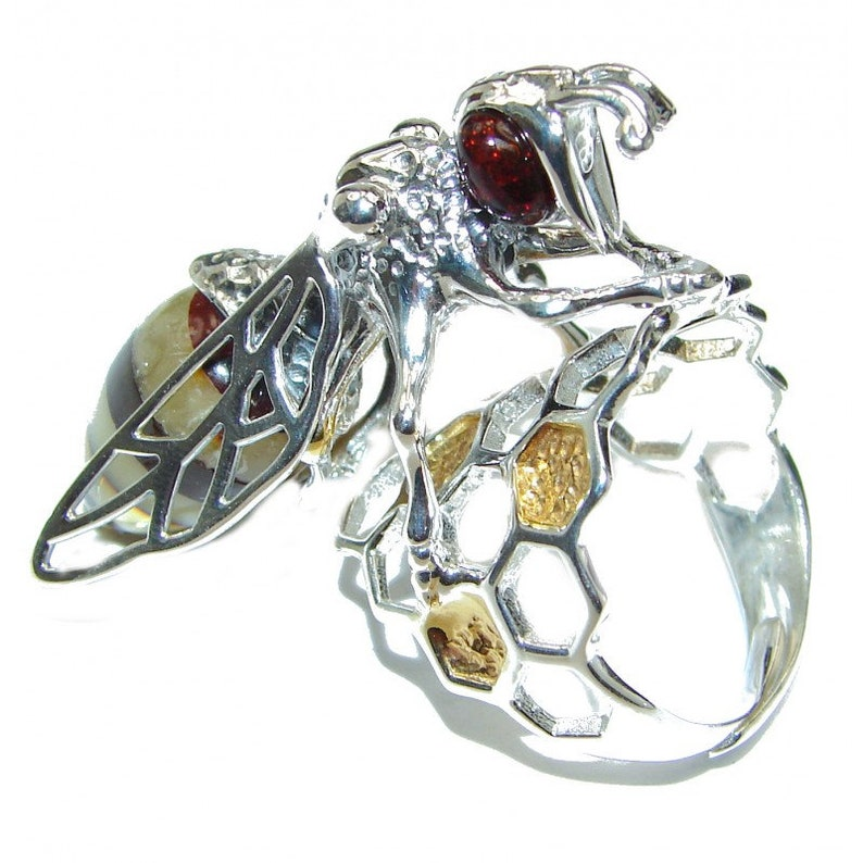 Size 7 Amber weight 12.90g code 5-sie-20-77 W 1 dim L- 1 5 8 Adjustable T- 5 8 inch Sterling Silver Ring